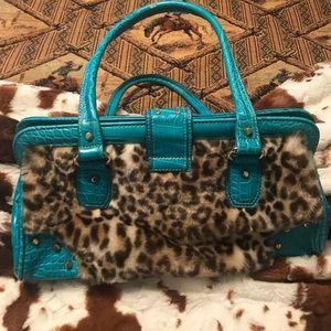 Kathy Van Zeeland leopard and turquoise bag